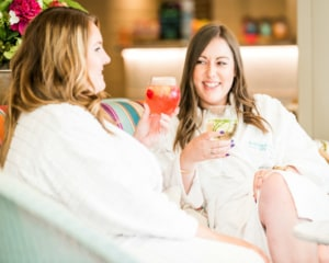 Friends laughing with cocktails and relaxing