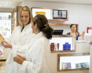 Guests looking at skincare products during spa break