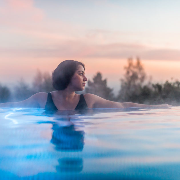 Guest relaxing in the infinity pool at Ragdale Hall