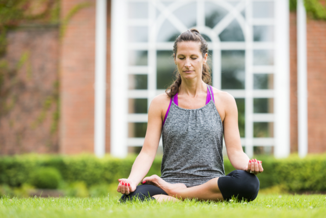 Guest taking part in yoga outside Ragdale Hall