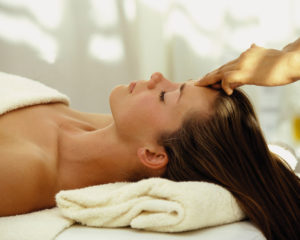 Lady receiving a deeply relaxing Holistic Therapy.