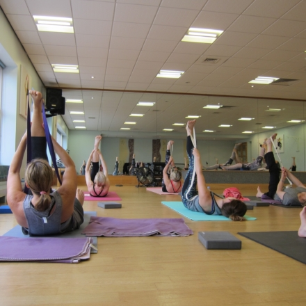 Guests stretching in an fitness class at Ragdale Hall