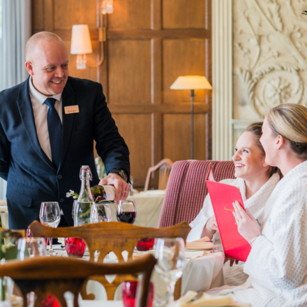 Guests being served wine in Ragdale Hall Spas Dining Room