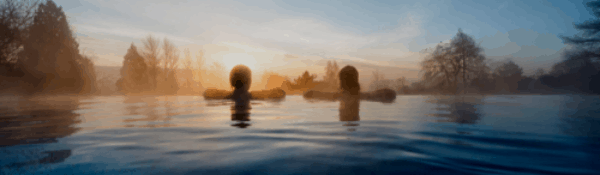 Two Ladies enjoying Twilight from the Rooftop Infinity Pool