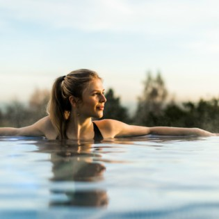 Guest reflecting in Rooftop Pool