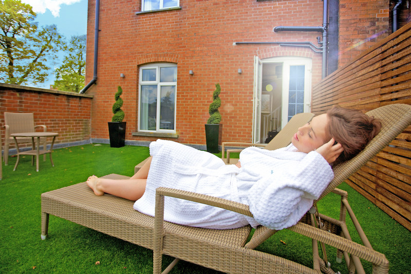 Guest relaxes on suite terrace at overnight spa break hotel