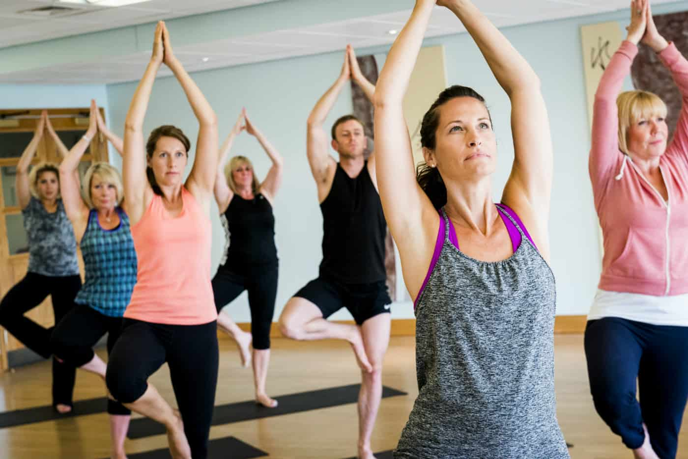 Guests doing Yoga in studio during fitness break