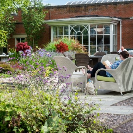 Guests enjoying back garden during spa break