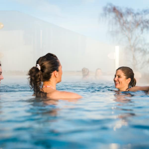 Guests enjoying rooftop infinity pool at luxuary spa in the midlands