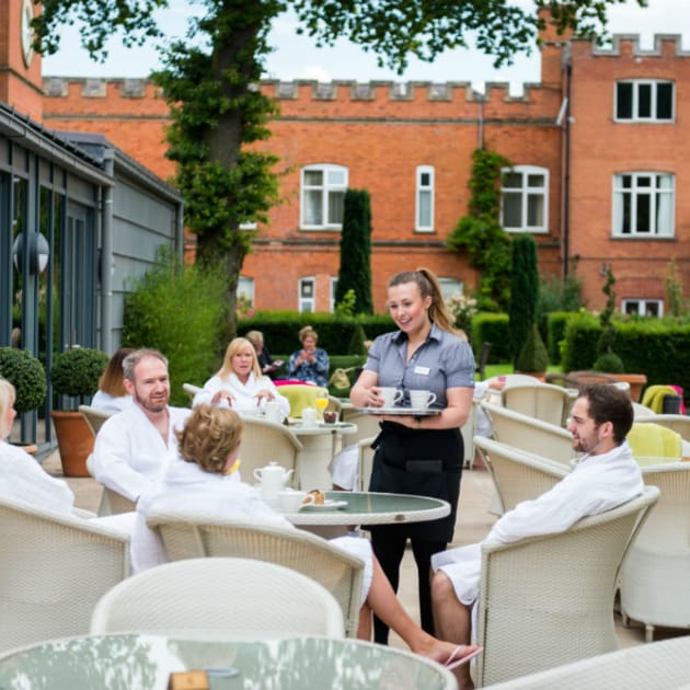 Guests on Verandah Bar Terrace at Ragdale Hall
