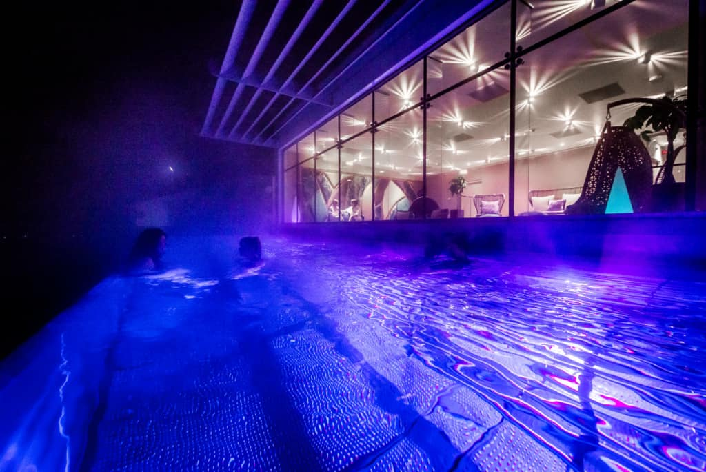 Infinity pool at night during overnight spa breaks