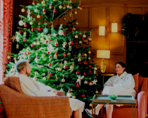 Couple in Reception at Ragdale Hall Spa by the Christmas Tree