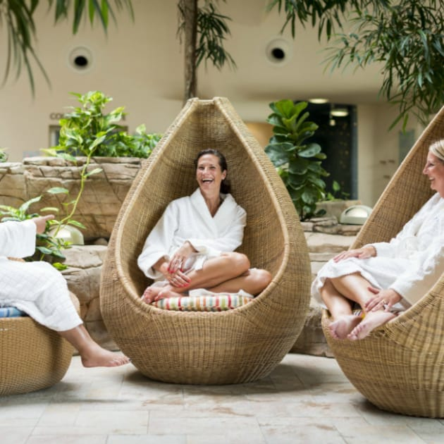 Guests chatting in Thermal Spa wicker pods