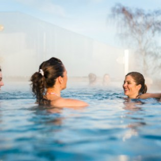Guests enjoying rooftop infinity pool at luxury spa in the midlands