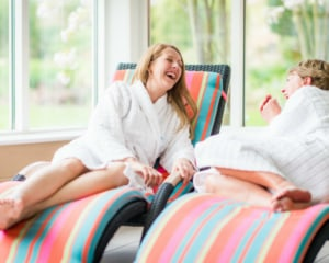 Guests laughing on loungers during weekend spa break