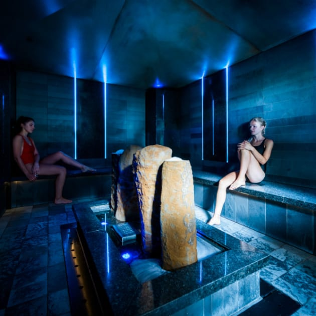 Guests inside Volcanic Salt Bath at Ragdale Hall