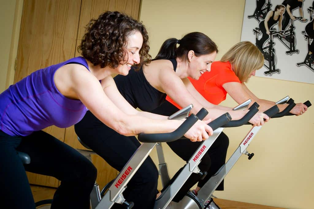 Guests participating in a spinning class