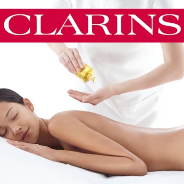 Clarins body oil application