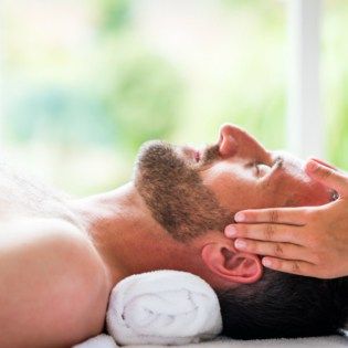 Male guest enjoying a relaxing facial