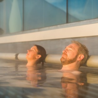 Couple relaxing in the Rooftop Infinity Pool