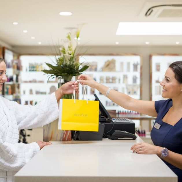Guest purchasing products in the Beauty Shop