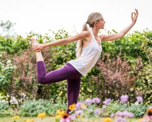 Guest doing yoga outside at Ragdale Hall