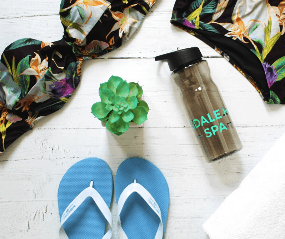 What to bring to a spa day. Flip flops, swimwear and water bottle